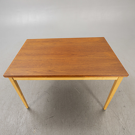 A 1960s teak and birch dining table.