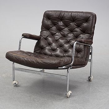 A 'Karin' leather upholstered lounge chair by Bruno Mathsson for Dux.