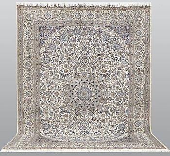 A carpet, Nain, Part Silk, S.K 9LAA, 394 x 294 cm.