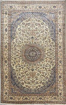 A carpet, Nain, part silk, 9 LAA, 636 x 408 cm.