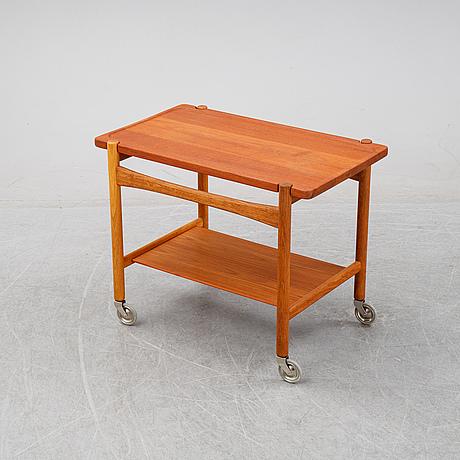 Hans j wegner, a teak serving trolley, for för andreas tuck, denmark, mid 20th century.