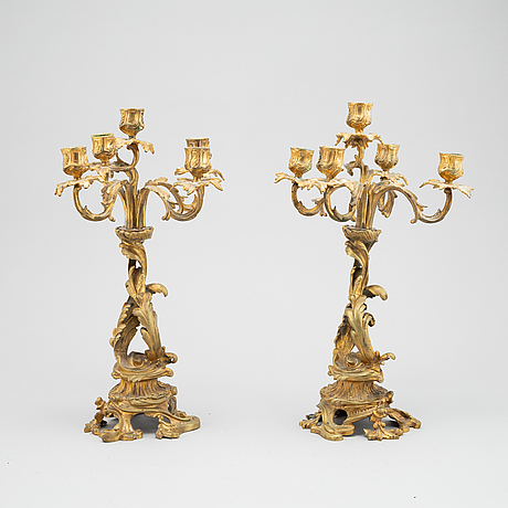 A pair of bronze candelabras. end of the 19th century.