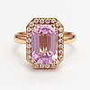 An 18k gold cocktailring with a ca. 6.02 ct kunzite according to engraving and diamonds ca. 0.28 ct in total.