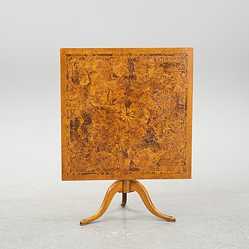 A Swedish Empire alder and birch tilt-top table, first part of the 19th Century.