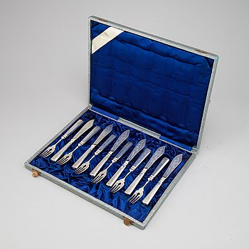 A set of twelve Hungarian early 20th century silver 800/1000 fish-cutlery.