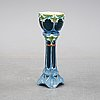 A majolica pedestal, from around the year 1900.