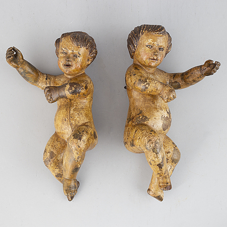 A pair of wooden figures, 18/19th century.