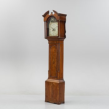A mahognay long case clock from around the year 1800, H Bunyan Lincoln.