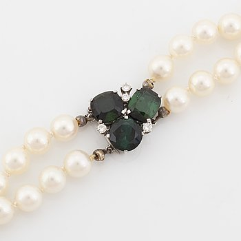 Cultured pearl necklace, clasp Torndals 18K white gold with green tourmalines and brilliant cut diamonds.