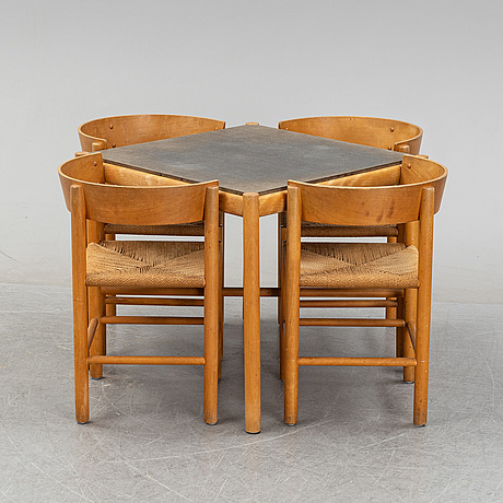 An beech dining table with av painted top and four oak chairs by mogens lassen for fritz hansen, designed 1964-65.