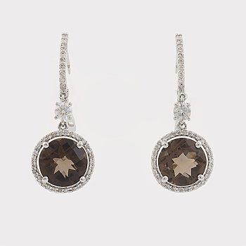 Smoky quartz and brilliant cut diamond earrings.