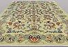 A carpet, figural royal keshan, ca 434 x 330.
