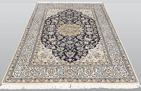 A carpet, nain part silk, sk 9 laa, ca 244 x 155 cm.