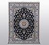 A rug, nain, part silk, ca 242 x 167 cm.