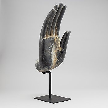 A wooden sculpture of Buddhas hand, Thailand, 20th century.