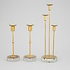 Gunnar ander, a set of three brass and glass candlesticks from ystad metall.