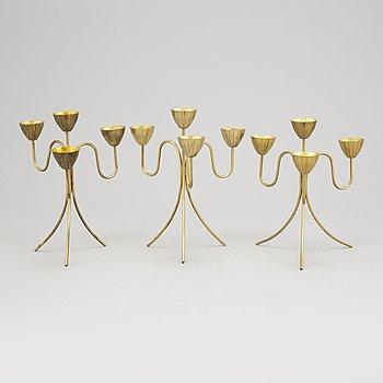 Gunnar Ander, a set of three brass five-light candelabra from Ystad Metall.
