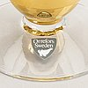 Gunnar cyrén, a set of 10 champagne glasses and one decanter nobelservisen orrefors later part of the 20th century.