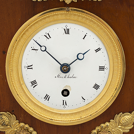 An empire mantel clock, early 19th century.