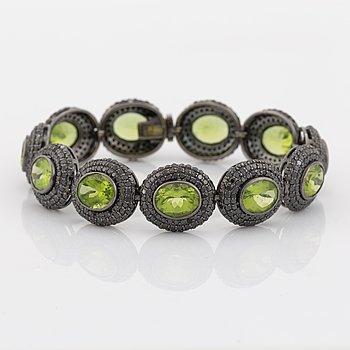 Peridot and brilliant cut black diamond bracelet.
