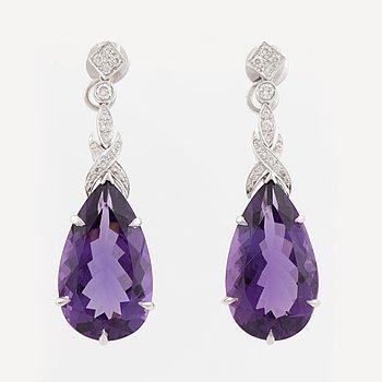 Pear shaped amethyst and brilliant cut diamond earrings.