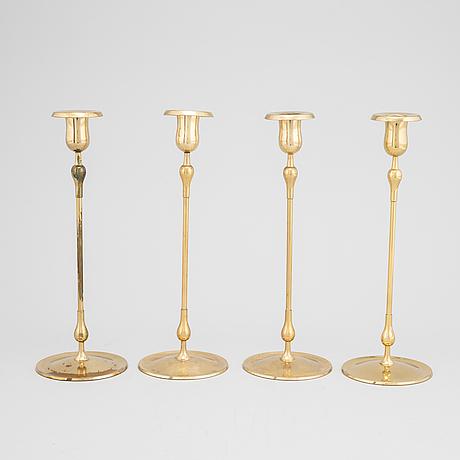 Gunnar ander, a set of four brass candlesticks from ystad metall.