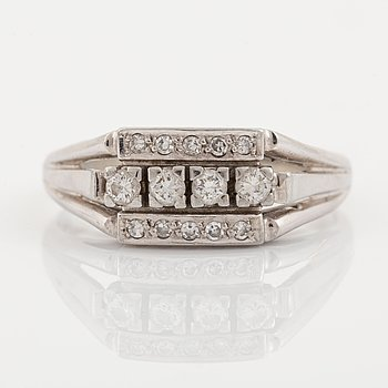 18K gold ring with diamonds.