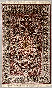 An old Oriental silk carpet ca 190x123 cm.