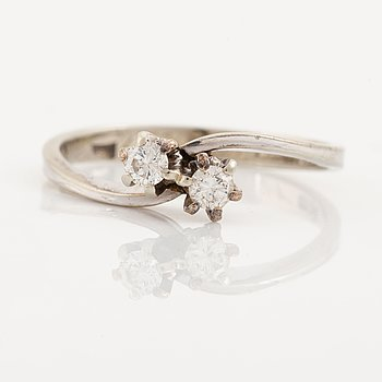 18K white gold and brilliant cut diamond cross over ring.