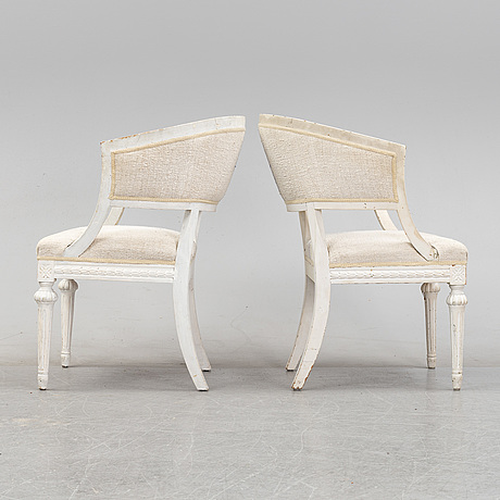 A pair of gustavian style armchairs from around year 1900.