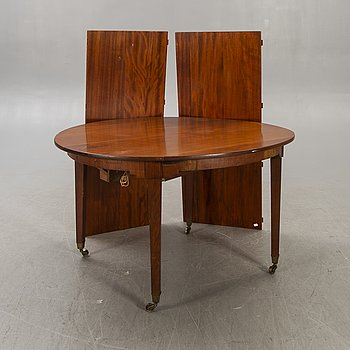 a 19th century English mahogany dining table.