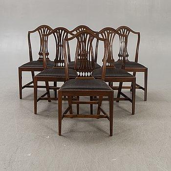 A set of six mahogany Hepplewhite style 20th century chairs.