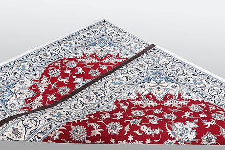 A carpet, nain, part silk, ca 238 x 170 cm.