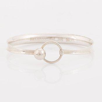 A silver Erik Granit bracelet.