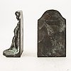 Axel gute, a pair of signed bronze book stands.