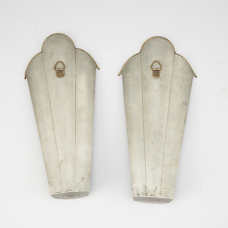 A pair of pewter wall sconces, firma svenskt tenn, 1928.