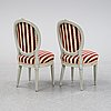 A pair of gustavian chairs by anders swensson, from around the year 1900.