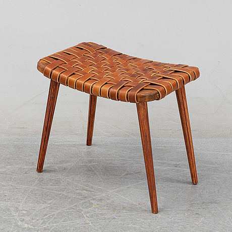 A leather upholstered stool, 1950's.