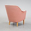 A 'samspel' lounge chair by carl malmsten, second half of the 20th century.