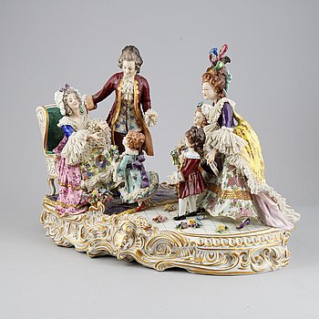 A Rococo style porcelain figurine group, Rudolstadt Volkstedt, Germany, early 20th Century.