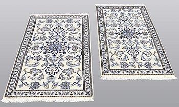 Two Nain rugs, part silk, ca 132 x 74 cm.