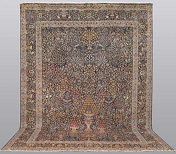 A carpet, Kerman, ca 420 x 298 cm.