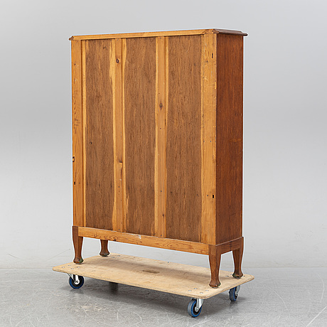 An oak book cabinet, early 20th century.