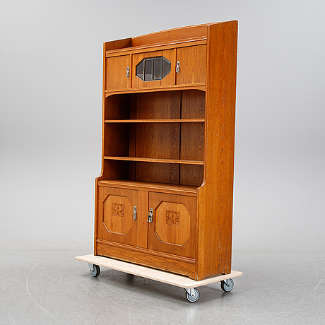 An oak cabinet and bookcase, early 20th century.