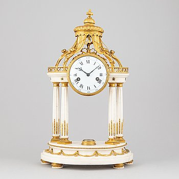 A Louis XVI marble and gilt bronze mantel clock, late 18th Century.