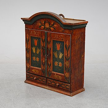 A Swedish provincial painted wall hanging cabinet, dated 1852.