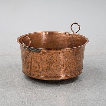 An 19th Century copper cauldron.