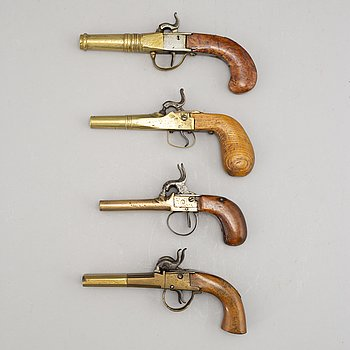 A lot with four brass percussion pistols, second half of the 19th Century.