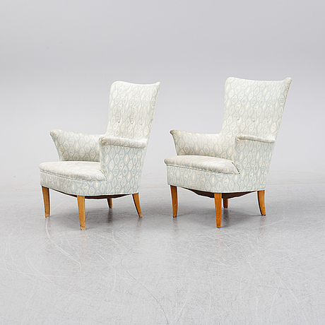 A pair of easy chairs by carl malmsten second half of the 20th century.