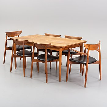 A set of two armchairs and four chairs by Harry Østergaard, Randers and a teak table.